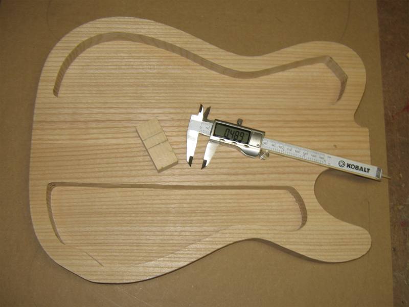Ash thinline telecaster mine is just a few thousandths from 50 i can easily take it further but with the body and top now at 45 lbs no need to cut away anymore mass maxwellsz